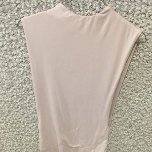 Suede powder pink body suit.